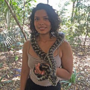 Jennifer Coronel poses holding a snake.