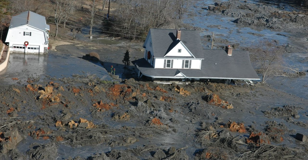 A residential home is nearly submerged by coal ash as a result of the Kingston ash spill.