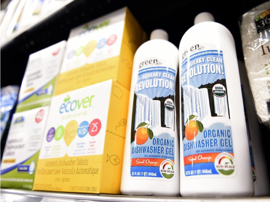Cleaning products arranged on a store shelf.